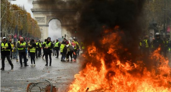 25112018 yellow vest protesters 550x295 - France Fuel Protests: Police Fire Tear Gas at 'Yellow Vest' Protesters