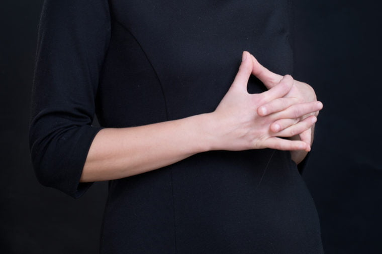 laced fingers body language 760x506 - Are Crossed Arms Rude? 8 Secrets Your Body Language Reveals About You