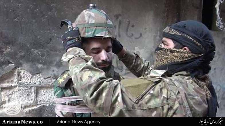 اعدام داعش - تصاویر/ اعدام وحشیانه یک افسر سوری توسط داعش (18+)