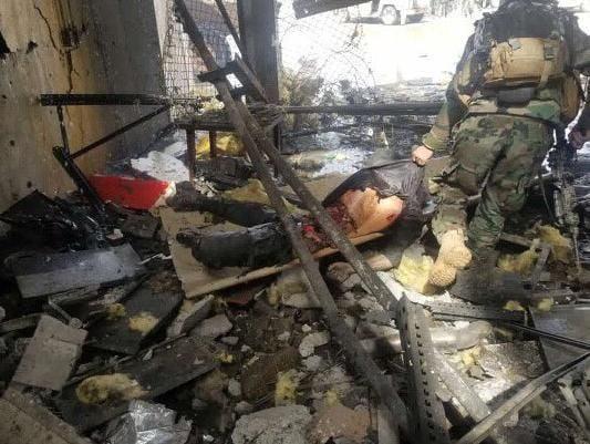 حمله طالبان هلمند 2 - تصاویری دلخراش از حمله طالبان بر پایگاه نظامی در هلمند(18+)